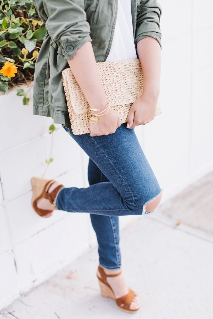 distressed denim, raffia clutch