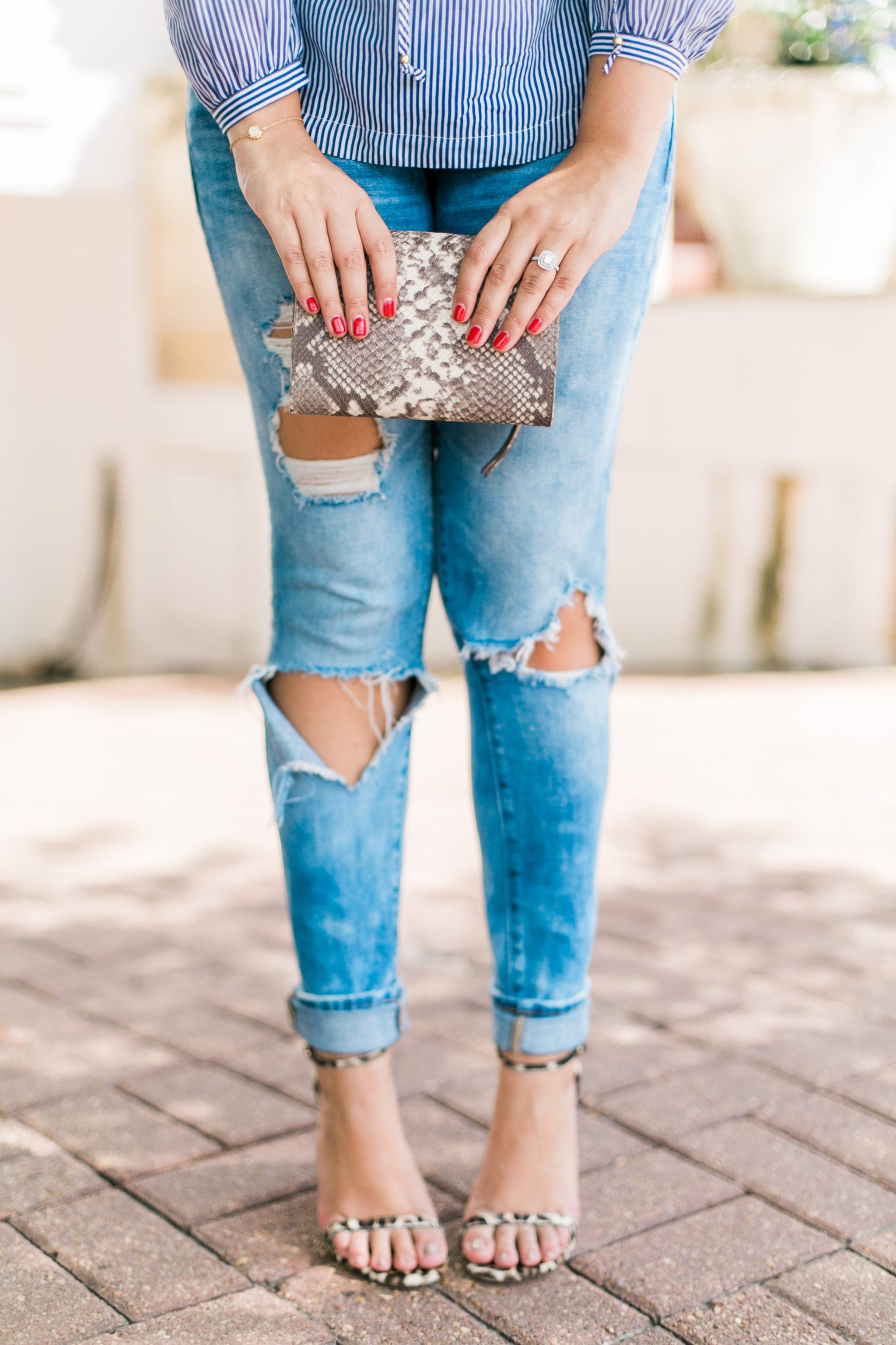Perfect distressed jeans, leopard heels