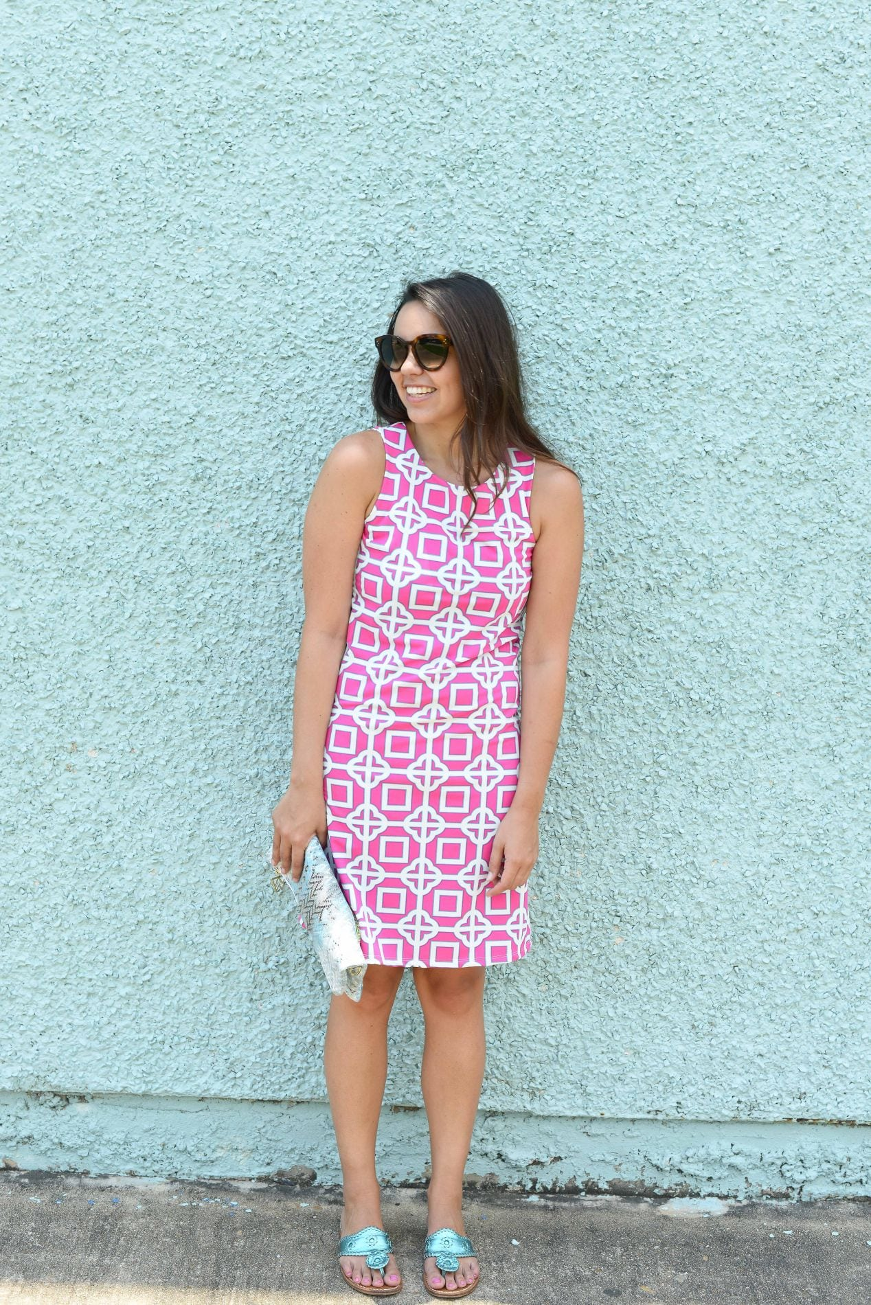 Turquoise wall & hot pink dress