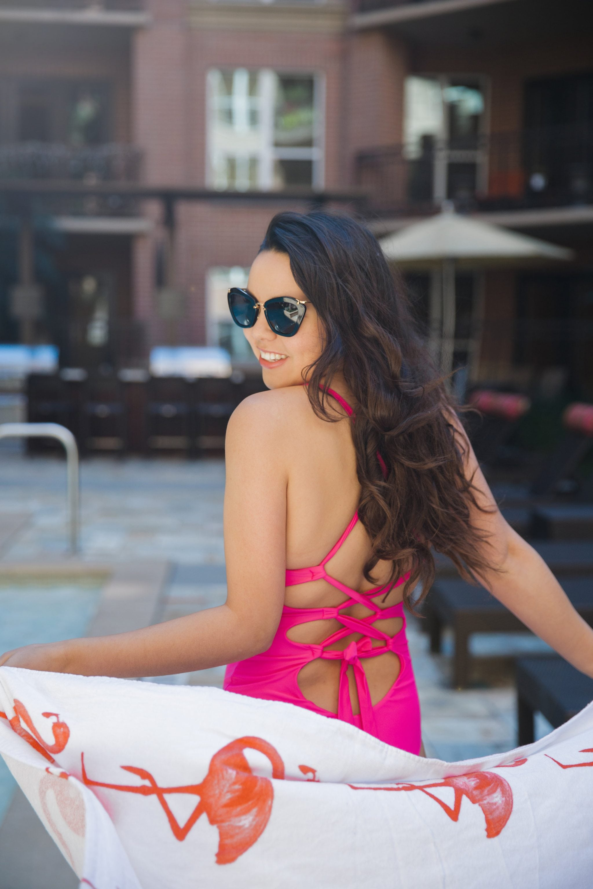 hot pink one-piece tie back swimsuit