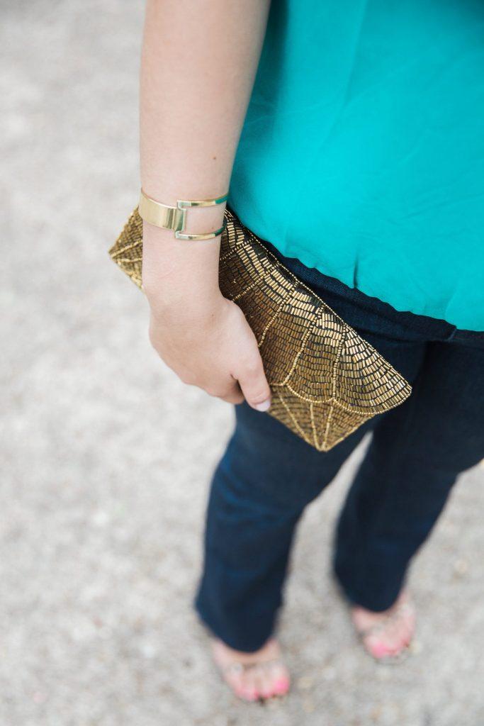 bronze beaded clutch and gold cuff