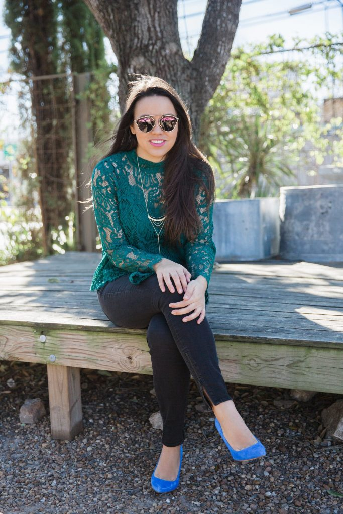 green lace top and black jeans