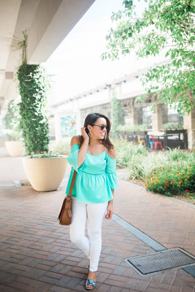 turquoise cold shoulder top and white denim