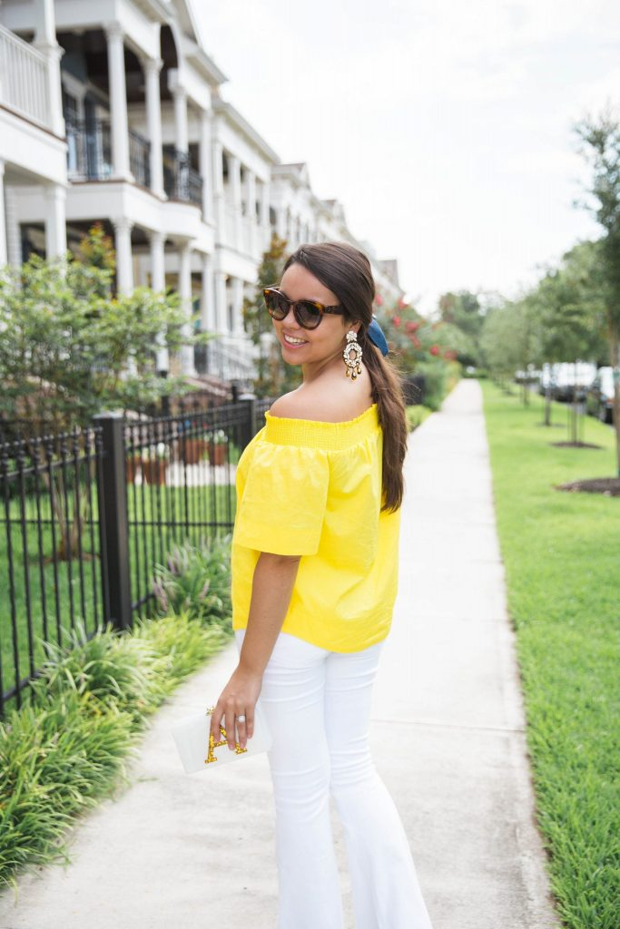 yellow off the shoulder top and white flares