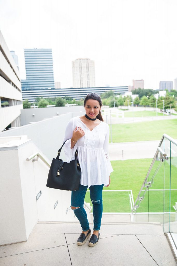 white peasant blouse and black hobo purse