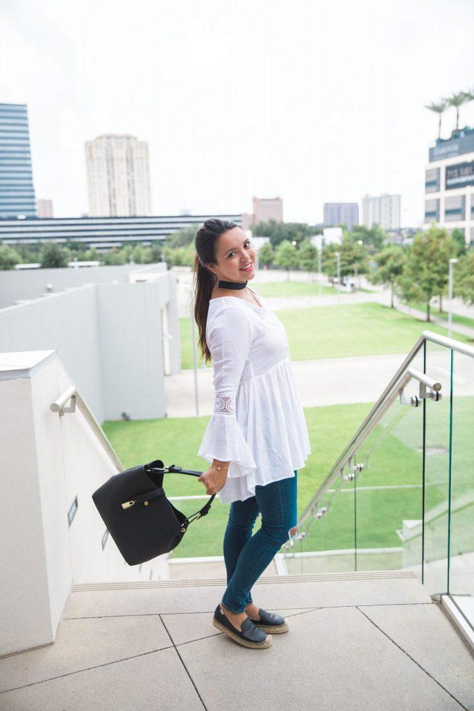 black hobo bag and white peasant blouse