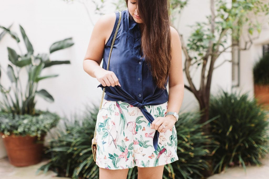 tie-up blouse with high-waisted shorts