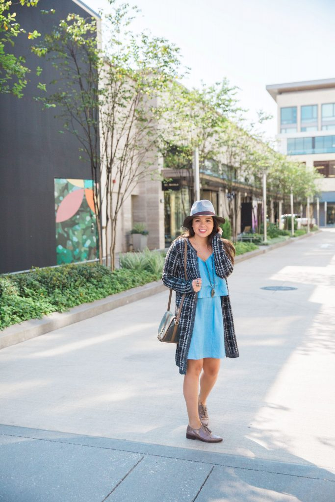 Duster cardigan layered over a chambray dress