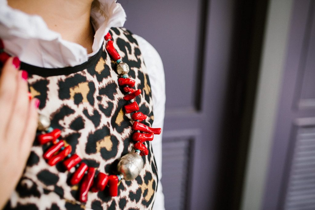 Leopard print dress and red statement necklace
