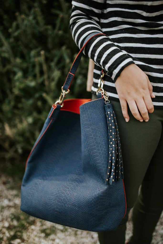 Faux leather navy and orange hobo bag, how cute is the studded, tassel detail?