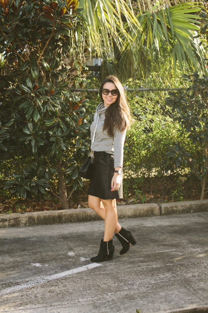 The coziest grey sweatshirt paired with a faux leather skirt for a casual yet dressed up look