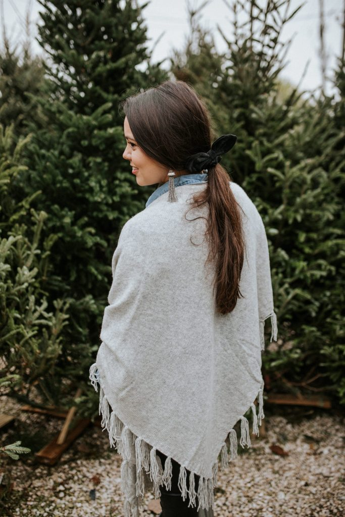 Accent a grey fringe wrap with velvet and tassel accessories