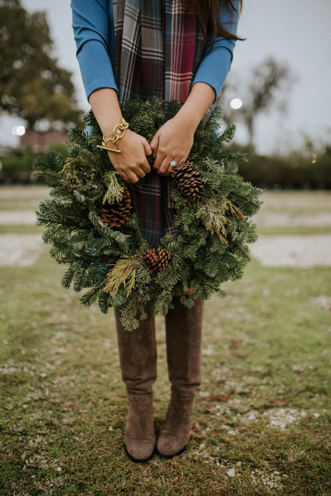 Holiday wreathes and knee-high suede boots