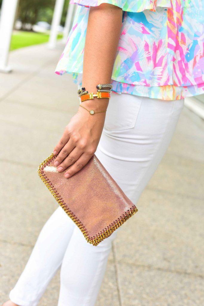 David Yurman bracelet stack | Hermes clic clac bracelet | Stella McCartney clutch