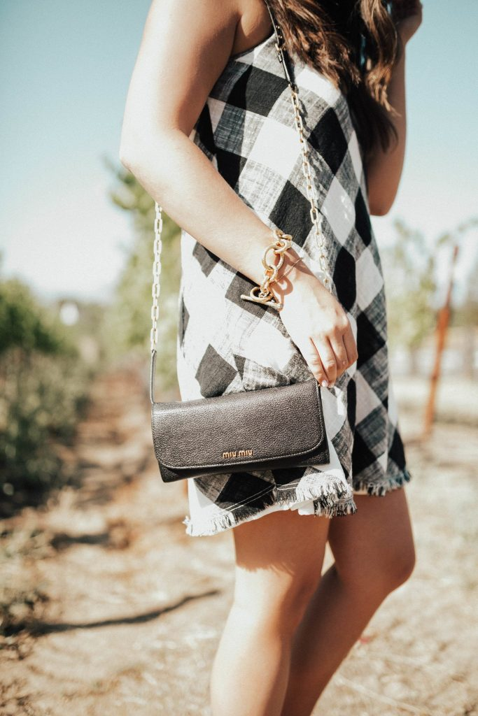 Anthropologie gingham dress, miu miu purse, gold bracelets