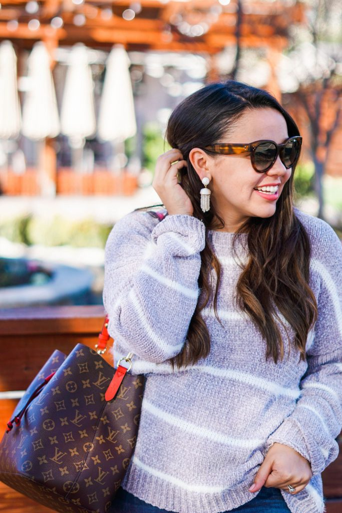 striped fuzzy sweater with tassel earrings