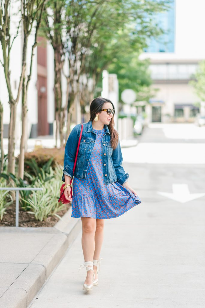 Denim jacket paired with a dress