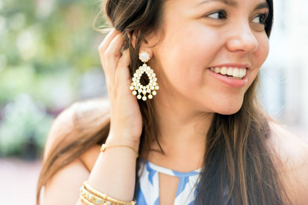 mother of pearl, gold statement earrings by ASHA