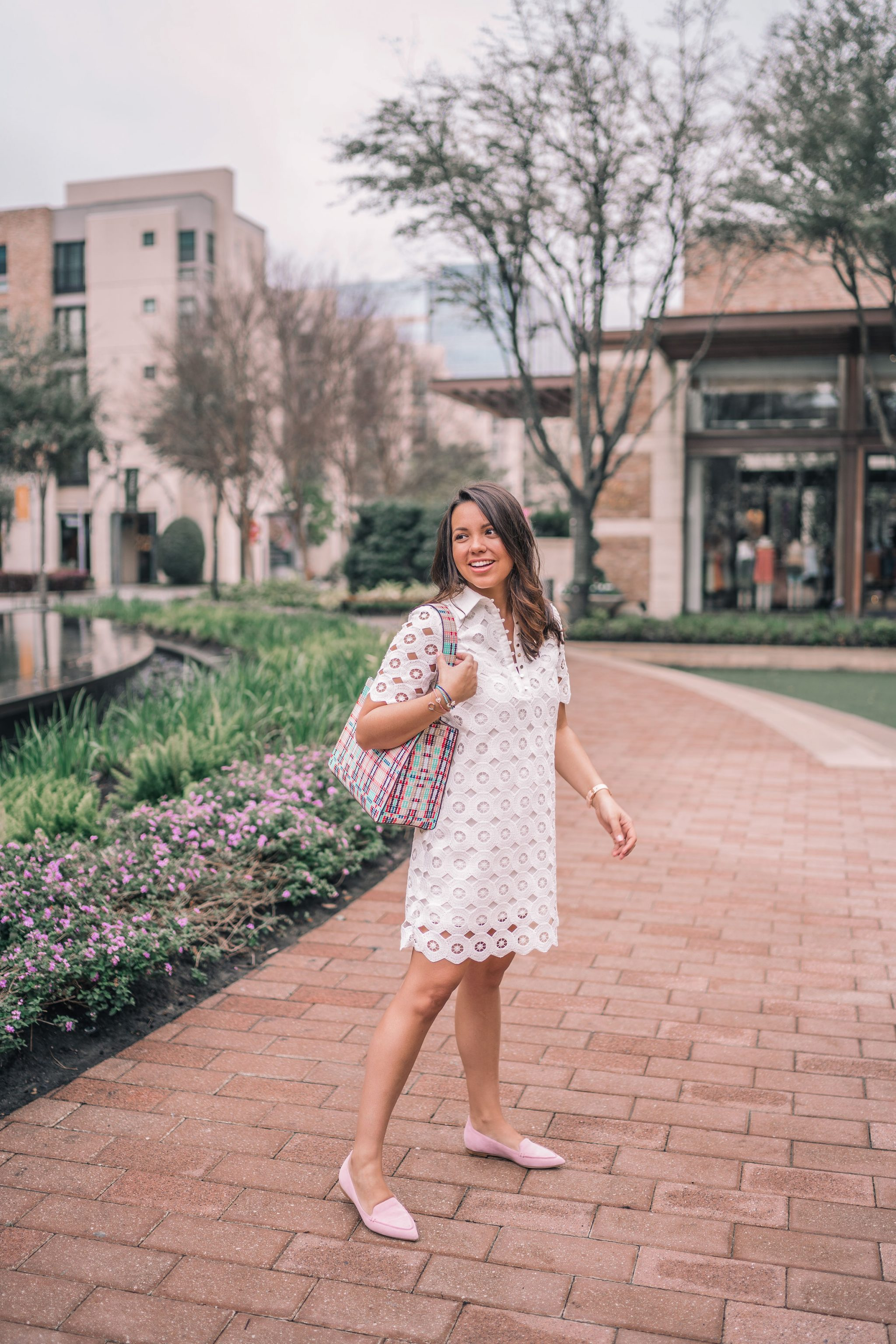 white eyelet collared dress and blush flats