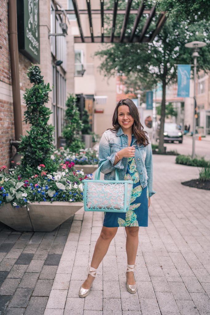 Denim jacket paired with printed dress | Adored by Alex