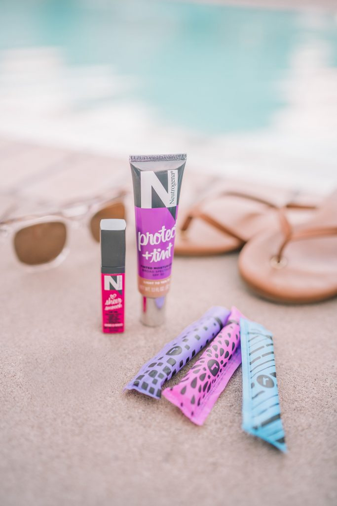 Neutrogena Tinted Moisturizer and sheer lip oil in my pool bag