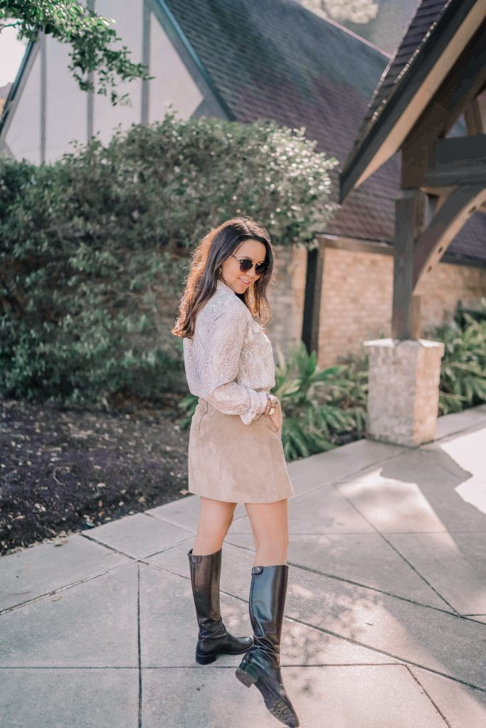 Chocolate brown riding boots and suede skirt pairing