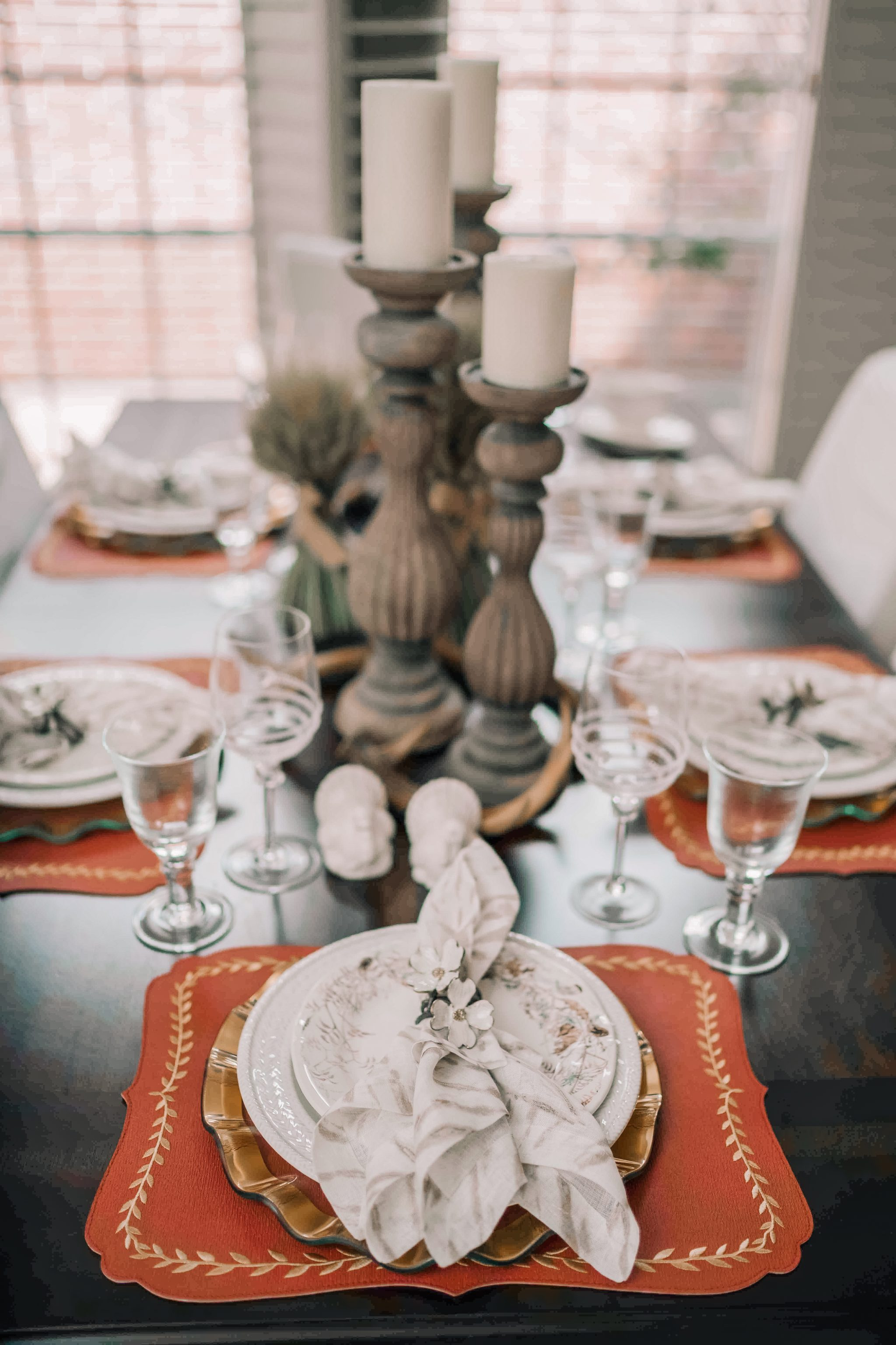 Carved wood candle holders as centerpieces