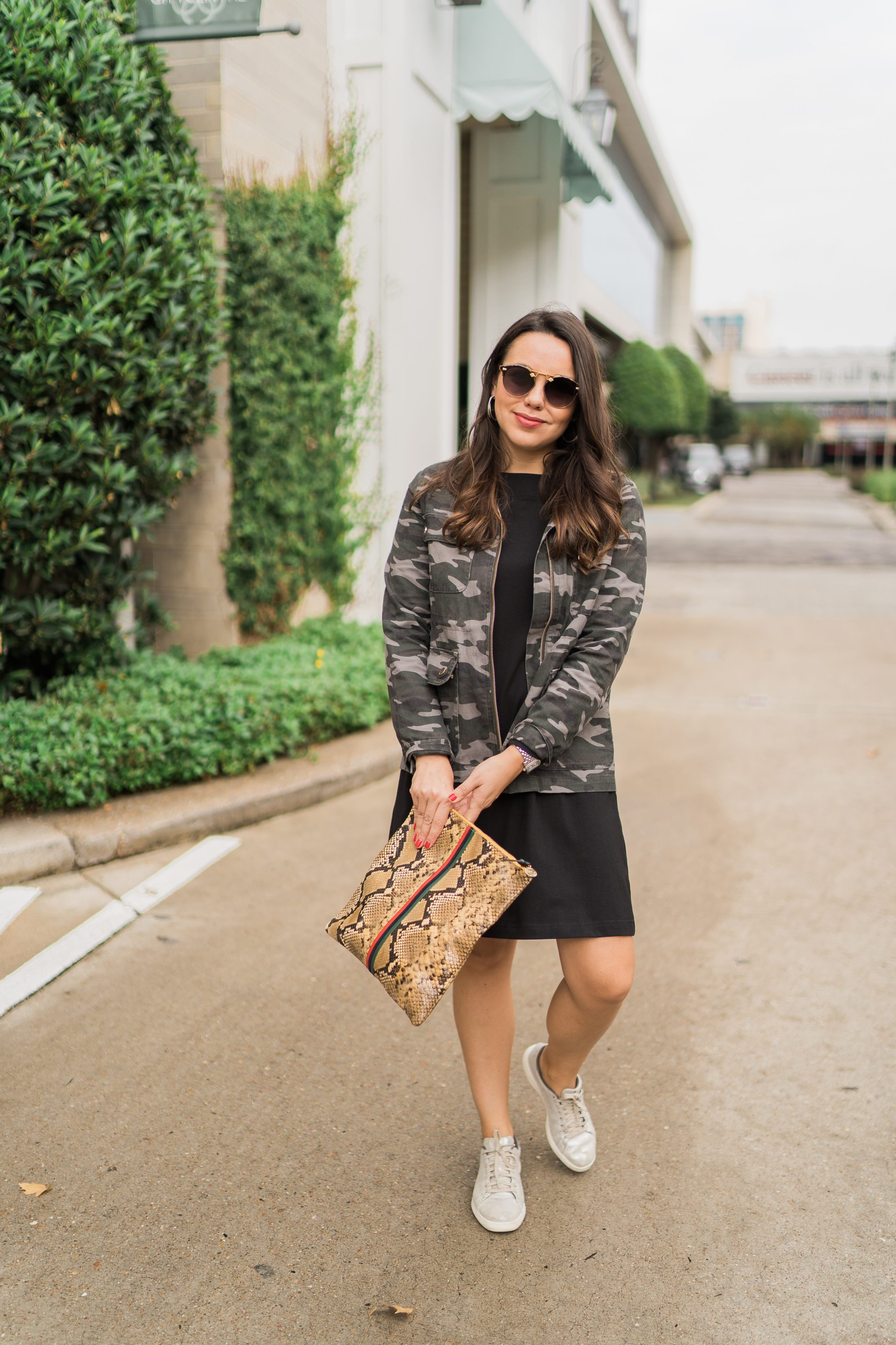 Camouflage jacket paired with a dress and sneakers | Adored by Alex