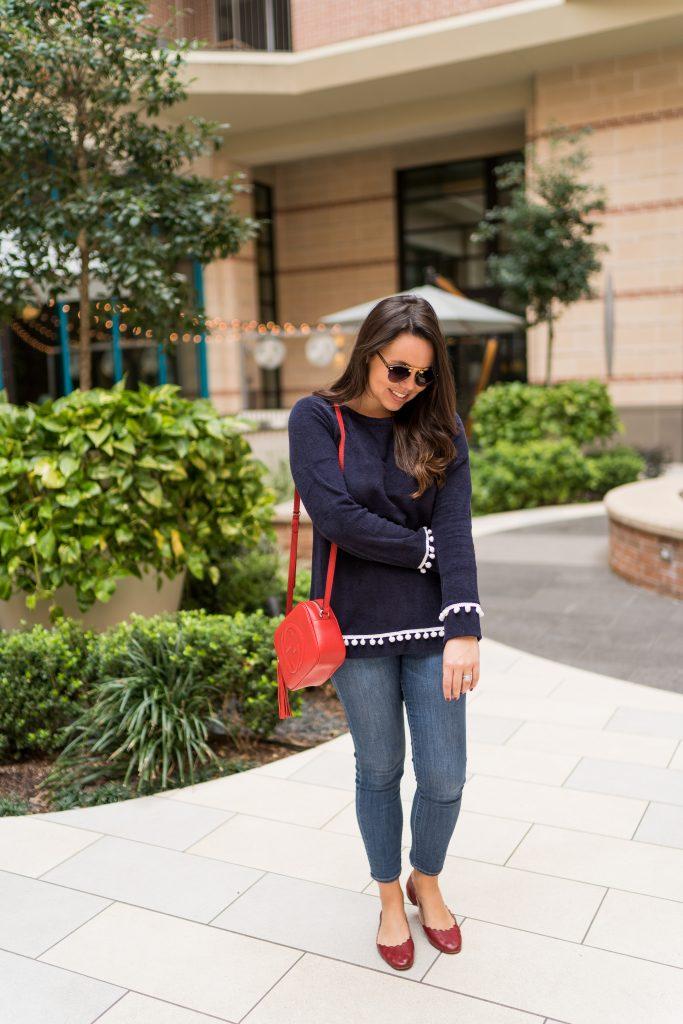 Preppy pom pom trim sweater and red accessories