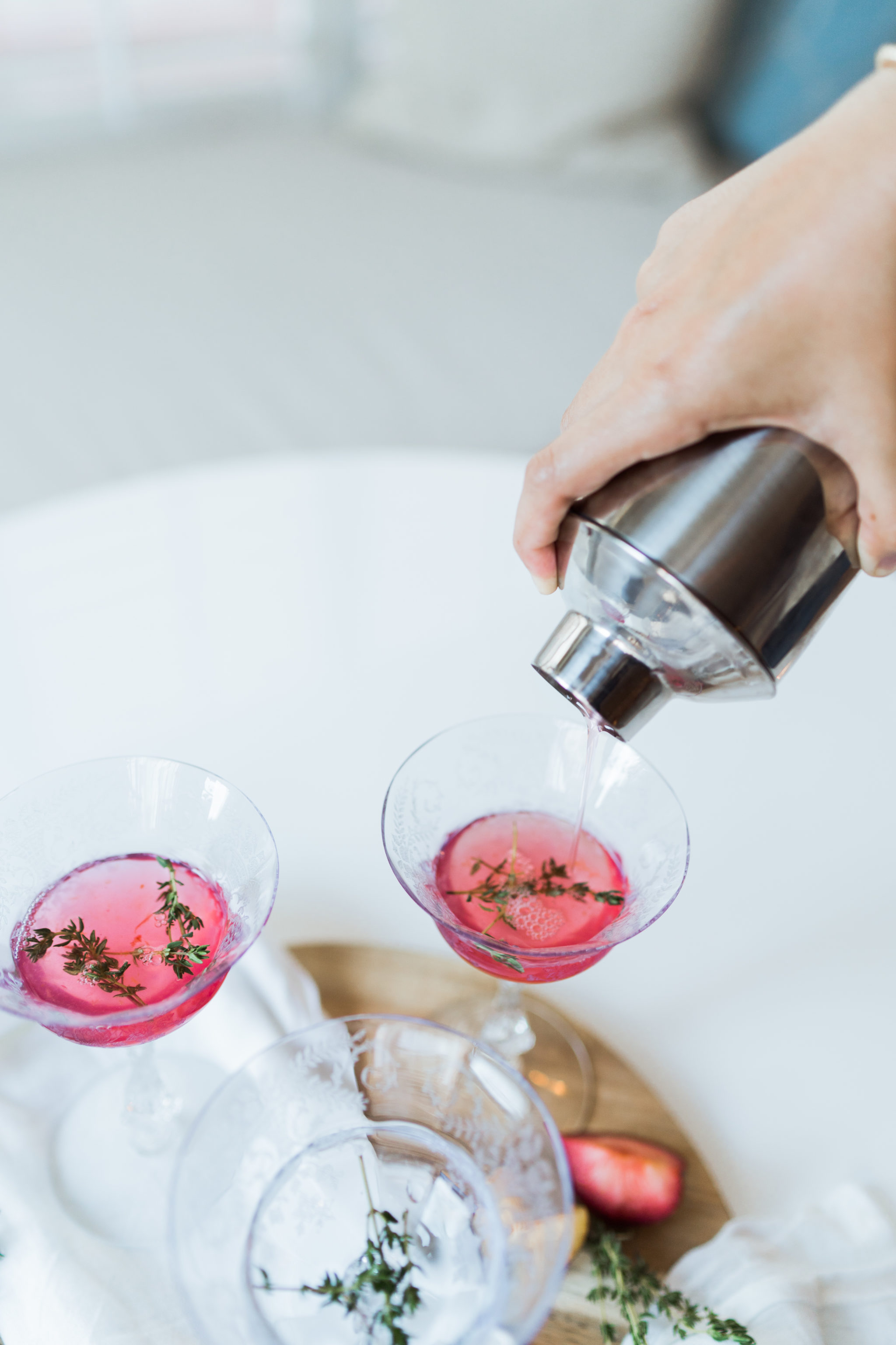 muddled fresh plum and thyme cocktail for fall