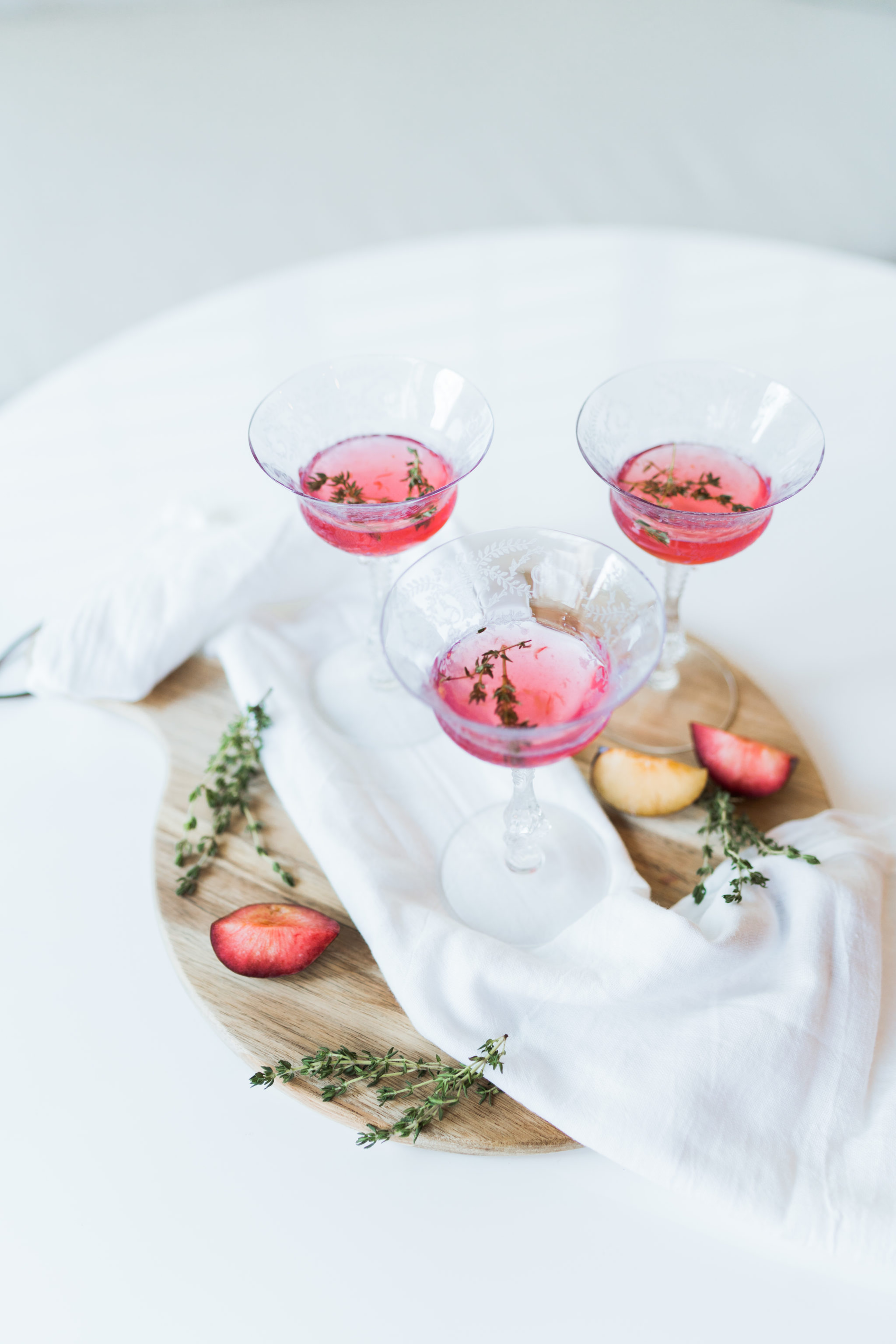 muddled plum and thyme cocktail