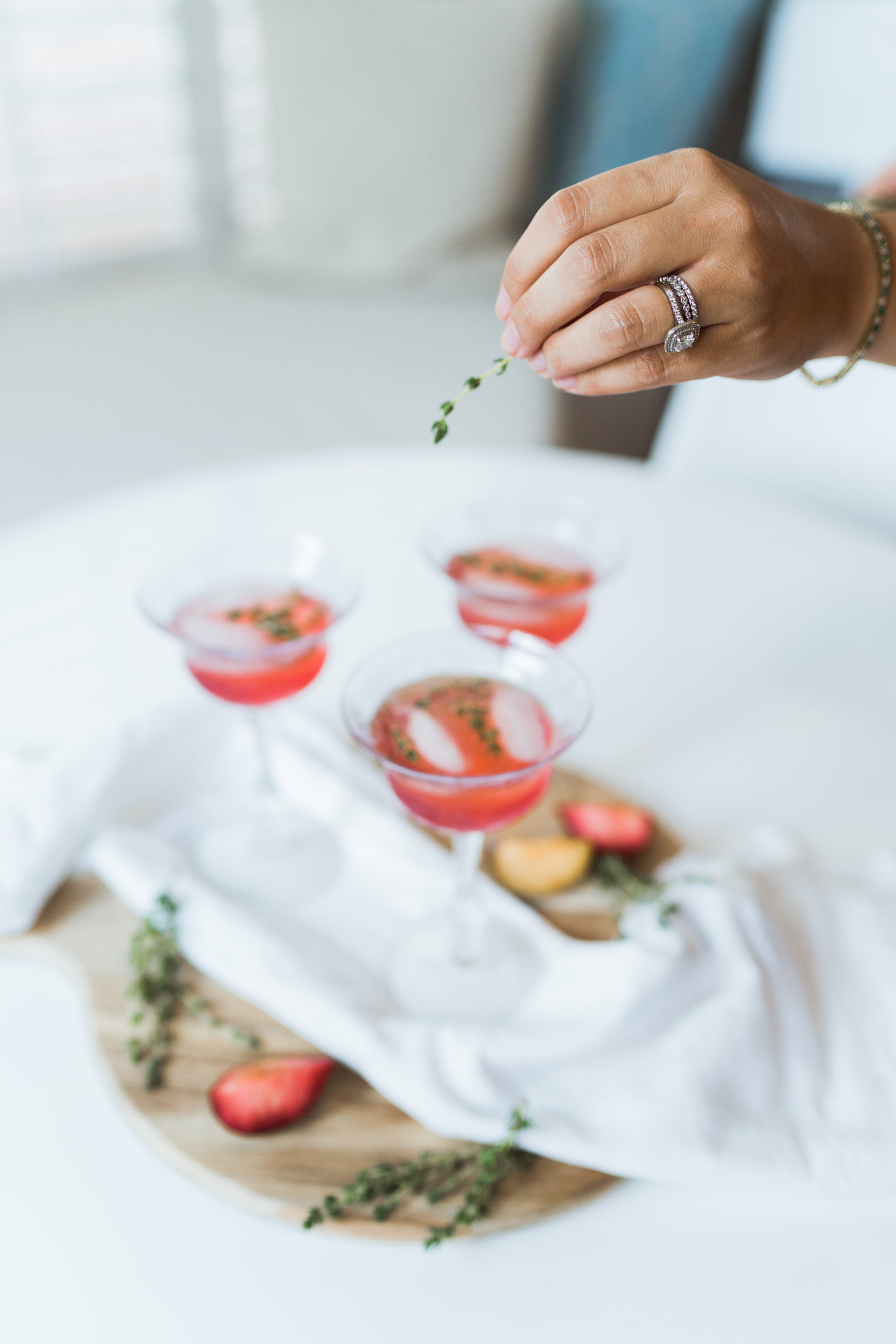 Fresh muddled plum and thyme cocktail