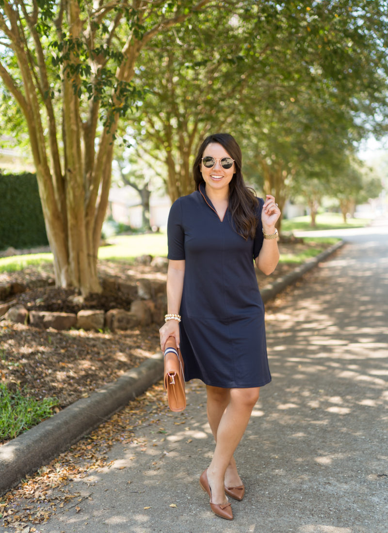 Classic navy dress and saddle accessories
