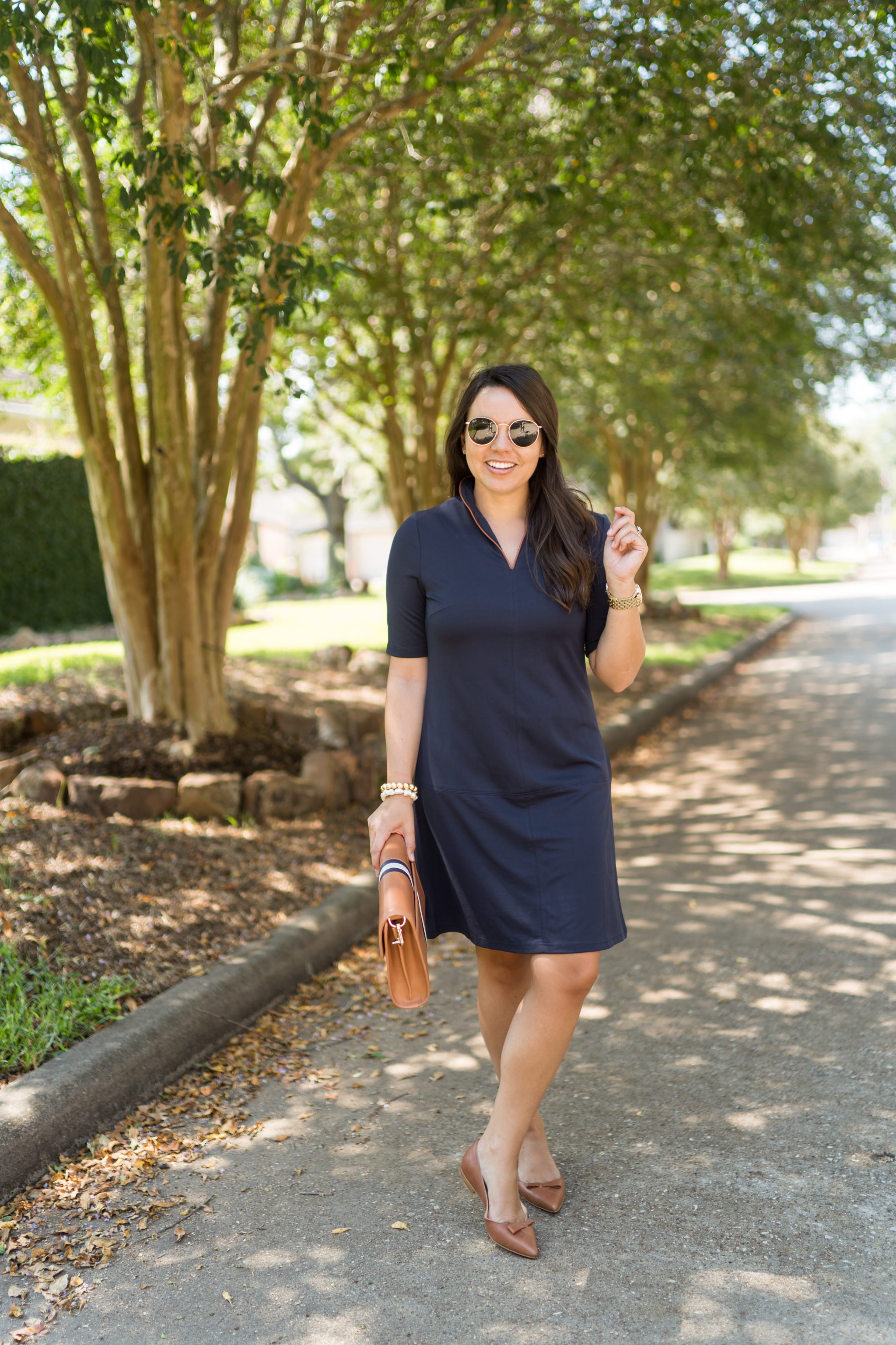 Classic navy dress and cognac accessories