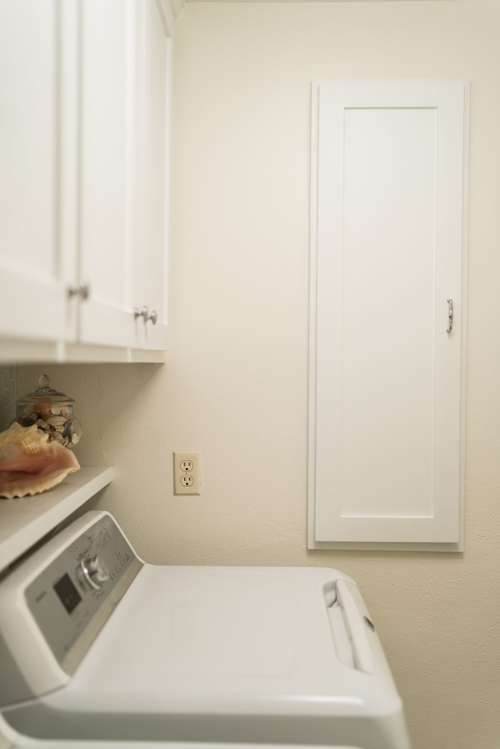 Laundry room custom cabinets and storage space