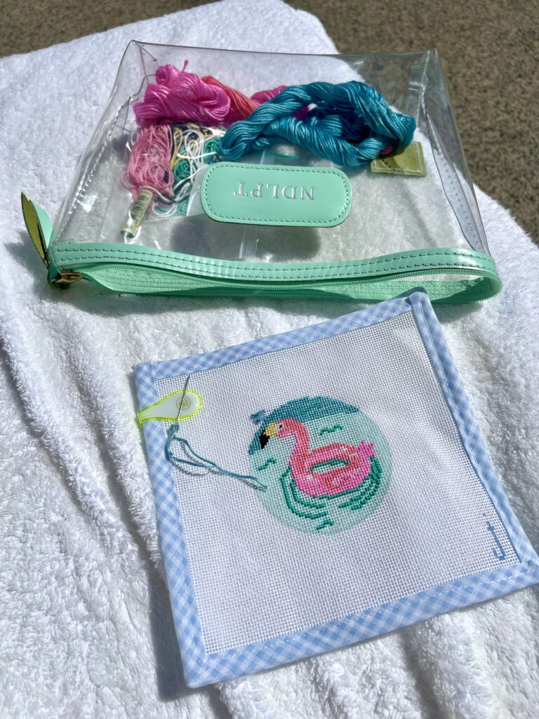 Flamingo pool float needlepoint canvas + Jon Hart accessories bag   Adored by Alex
